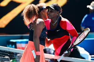 Serena Williams (right) embraces Naomi Osaka