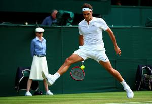 That shot: Roger Federer plays the ball between his legs and over the head of his stranded opponent on Centre Court