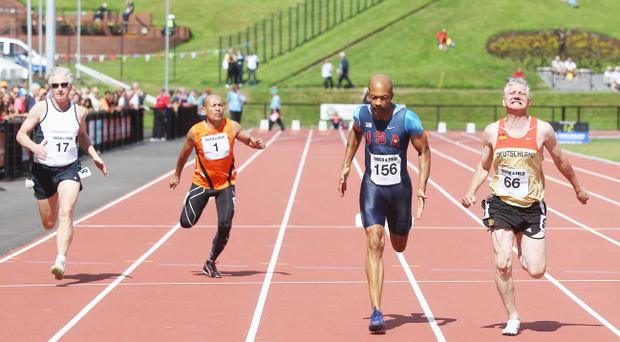 Age no barrier: Charles Williams (58) of the USA, the oldest sprinter in town, wins his 100m heat