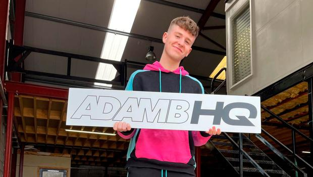 ONLINE HIT: Adam, who has 3.1 million subscribers, in his new warehouse