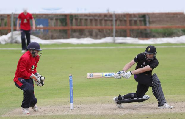 Instonians' Andrew White helps his side to a shock win over Waringstown