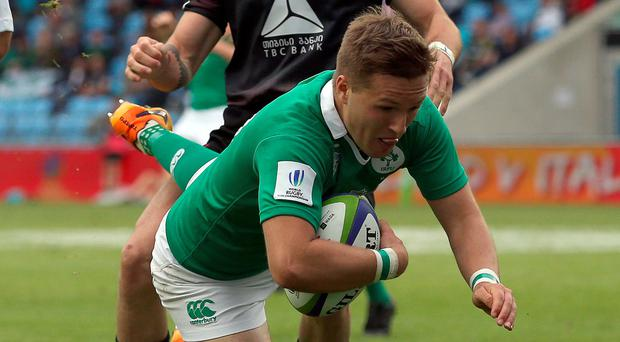 Made it: Ulster's Johnny McPhillips scores a try for Ireland yesterday
