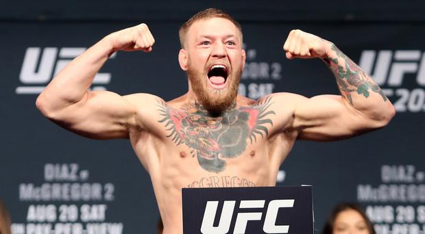 Conor McGregor charged with assault after Dublin bar punch