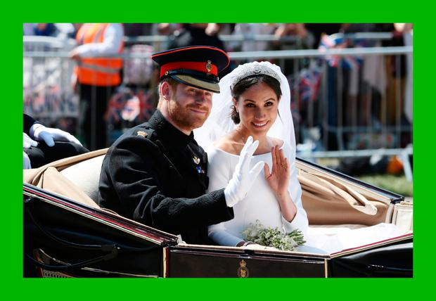 Prince Harry, Duke of Sussex and Meghan, Duchess of Sussex wave from the Ascot Landau Carriage during their carriage procession on Castle Hill outside Windsor Cast