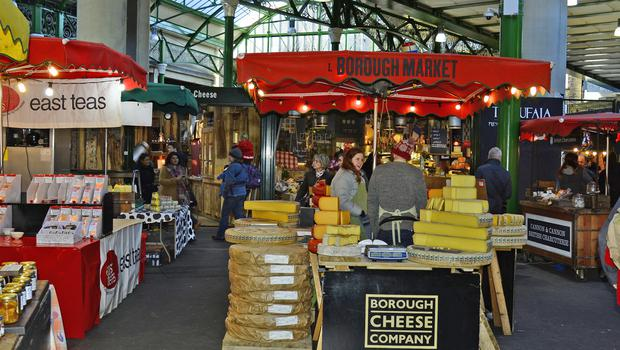 Unidentified people and different shops in Borough market in Southwark