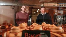 Darren McKibben (right) and business partner Matthew Toner (left) at their Black Box Donuts shop in Newcastle Co Down. They have recently opened a shop on Belfast's Lisburn Road. Picture by Colm O'Reilly