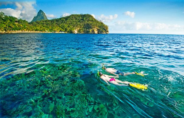Soufriere, St. Lucia; snorkelers enjoying the Caribbean with Pitons in the background