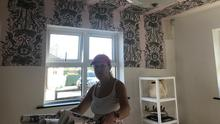 LABOUR OF LOVE: Alison gets to work papering