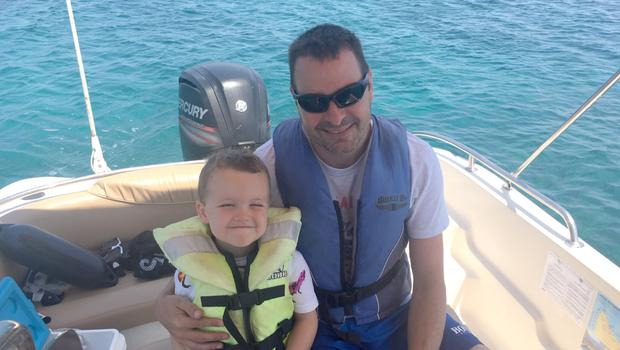Chris and his son Scott in their self-drive boat