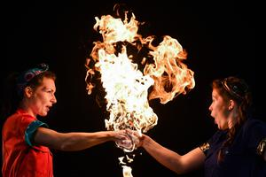 Aoife Raleigh (an engineer) and Maria Corcoran (a chemist) perform a fire act during the launch of Strong Women Science at the Pleasance, Edinburgh Science Festival