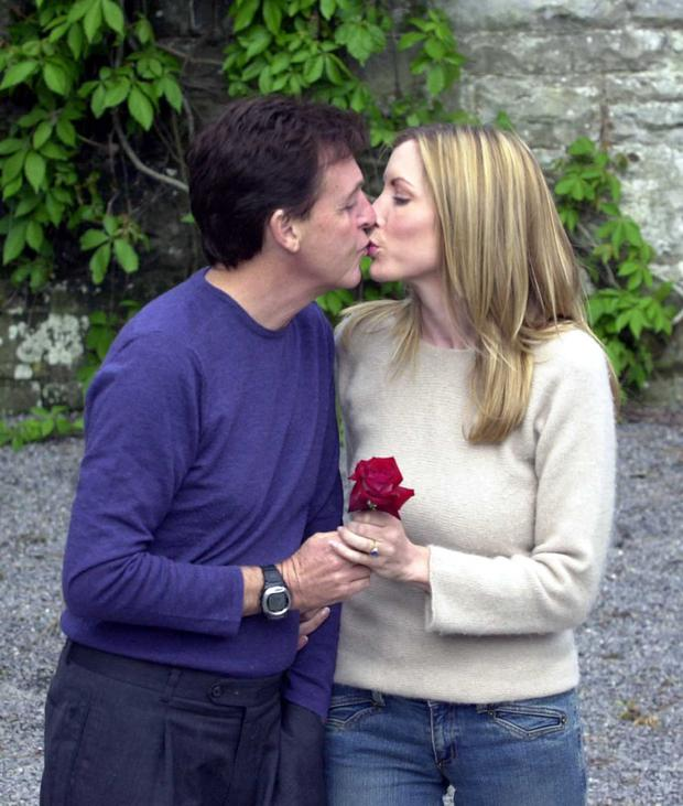 Singer Sir Paul McCartney and his fiance model Heather Mills kiss at Castle Leslie June 10, 2002 in Glaslough Village, County Monaghan, Ireland.