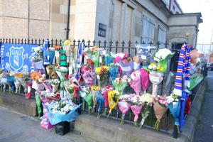 Flowers at the scene of Ian Ogle's murder in January 2019