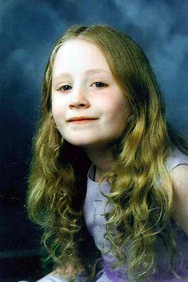Janet Devlin as a child