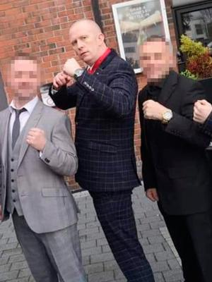 UDA drug dealer and death driver Colin Simms at David 'Dee Dee' McMaw's wedding in Carrickfergus. Simms is centre.