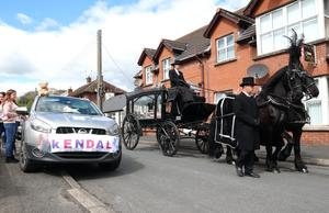 Neighbours and friends paid tribute to five year old Kendal Flitcroft as her pink coffin was carried from her Conlig home by a horse drawn hearse during her funeral.