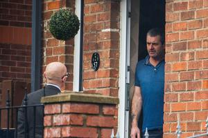 Sunday Life's Chris Woodhouse speaks with Noel Parker at a property off the Shore Road in north Belfast. (Liam McBurney/RAZORPIX)