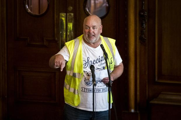 Harland and Wolff steel worker Joe Passmore addressing Belfast City Hall during emergency council meeting to discuss the threat of the closure to the shipyard.