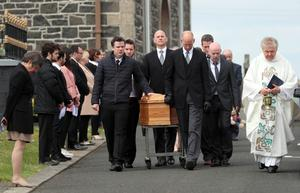 The coffin of former SDLP MLA John Dallat leaves St Mary's church outside Kilrea for burial in the church graveyard