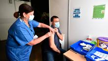 Way forward: One of the first vaccines is administered at the Odyssey SSE Arena