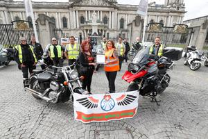 Debbie Heaven and Julie Martin holding the Spirit of Northern Ireland winners certificate on behalf of their group, Team Volunteer Bikers. Picture: Colm O'Reilly