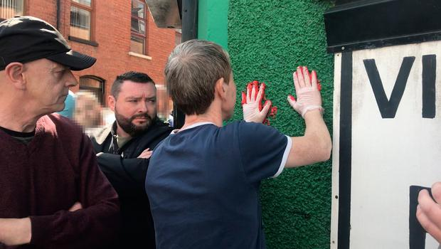 Friends of murdered journalist Lyra McKee defaced the walls of a dissident republican office in Londonderry with red paint. Cate McCurry/PA
