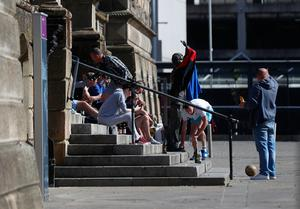 People drinking on the steps of the Custom house at Custom house square in Belfast City Centre.. Picture Colm O'Reilly Sunday Life 30-05-2020