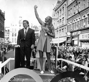 The delight on Mary Peters face as she waves at the thousands of people who lined the length of Royal Avenue to greet Mary and her trainer Buster McShane on her Olympic float.  8/9/1972