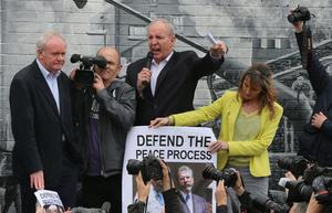 Martin McGuinness (left) and Bobby Storey (3rd left) address Sinn Fein supporters, joined by Martina Anderson (right) attending the unveiling of Gerry Adams in the Falls Road, Belfast