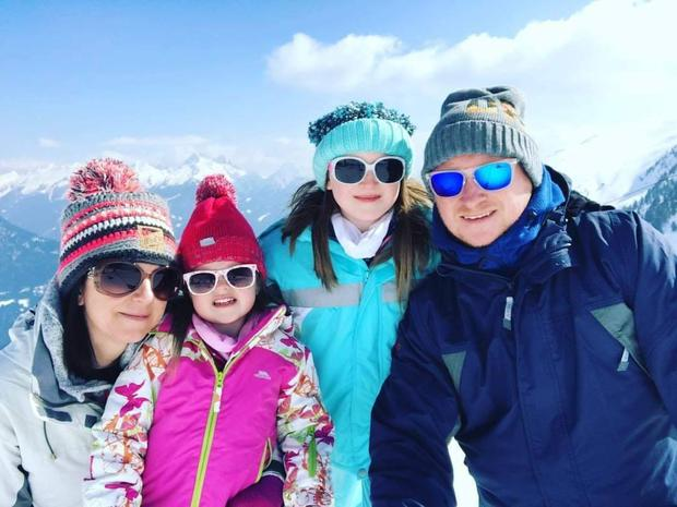 BARGAIN HUNTERS: Lynne and Andrew Callaghan with their girls Matilda and Lily-Belle on the Italian Alps