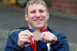 Scott Cromie with his medal