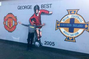 At the George Best mural in east Belfast