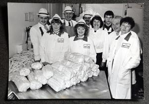 With staff at their sausage plant in the Eighties