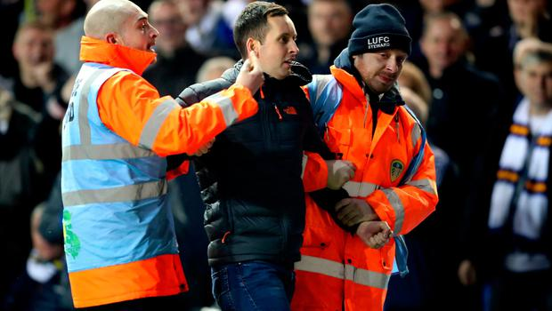 Craig McKelvey being escorted off the pitch.