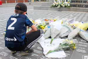 Fred, 10, looks at tributes left for World Cup hero Jack Charlton at Leeds United's Elland Road stadium