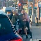 Gerard Devlin Jnr (white vest top) fight fighting with Francisco Noterantionio (Green jumper and shorts) on the Falls Road on Friday 3rd January 2020.