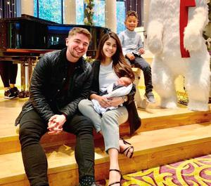 Jordan O'Keefe with baby Matteo, stepson Enrique and Myllena