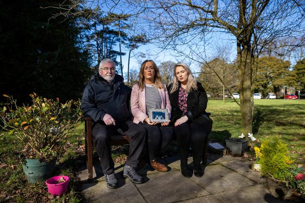 HEARTBREAK: Lisa Dorrian's father John and her sisters Michelle (centre) and Joanne at a memorial bench to Lisa