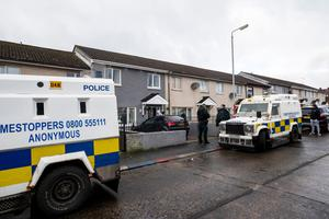 Police attend a property at Hopewell Cresent in the Lower Shankill, Belfast.