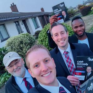 Caleb McCready (centre) - DUP Councillor for Lisburn Downshire West taking a selfie during canvassing, with Paul Givan DUP MLA for Lagan Valley (second from right), Bas (right)