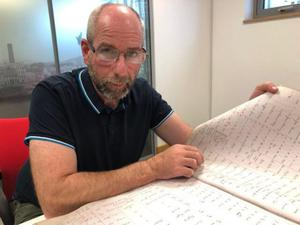 Gordon Adair searches through one of the previously secret files relating to the murder of Minnie Reid and the hanging of Haro