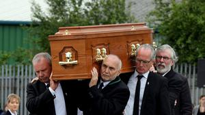 Provo top brass: Sean Hughes (left, Spike Murray, Gerry Kelly and Gerry Adams carry Bobby Storey's coffin.