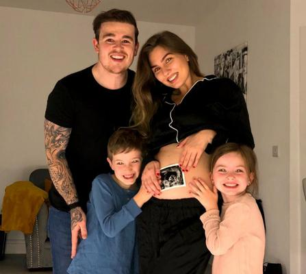 Eoghan Quigg, pictured after the treatment, with his partner Amy and her children.