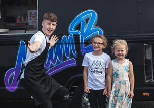 Derry YouTuber Adam B taking photos with fans during his the big 20k giveaway where he travelled around Derry in an ice cream truck giving gifts to people he believed deserved them.