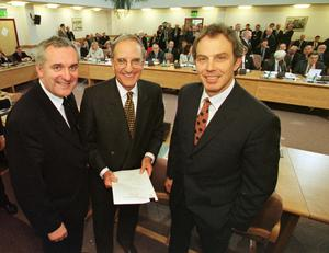 Former Prime Minister Tony Blair (right) former US Senator George Mitchell (centre) and former Irish Prime Minister Bertie Ahern (left) smiling after they signed the historic agreement for peace in Northern Ireland.