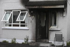 Crossan's fire-damaged home