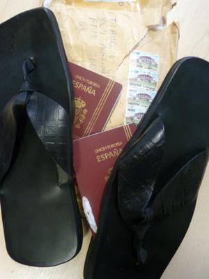 Fake passports hidden inside the soles of slippers
