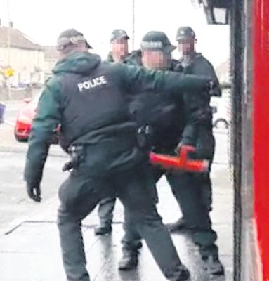 Police raid a business on the Springfield Road west Belfast on March 9th 2020.