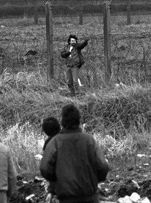 Loyalist Michael Stone attacks mourners at Milltown Cemetery in 1988