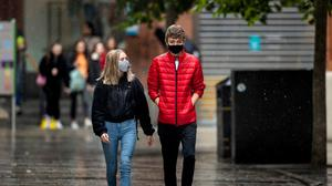 Face coverings will be mandatory in shops in NI from Monday. Credit: Liam McBurney/PA Wire