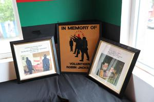 Photographs and posters which were part of the exhibition of Loyalist artefacts during the history of the Northern Ireland conflict held in the Raven Social Club in East Belfast.